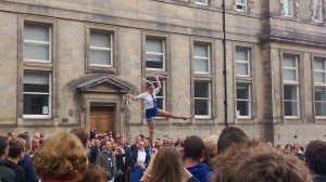 A circus performer on the Royal Mile during Ed Fringe.